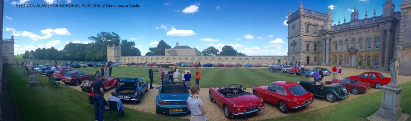 classic cars lined up in front of Wimpole Hall